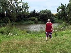 Watch a nasty pigtailed blonde belle sucking and riding a horny Grandpa's cock in a public park by the river.