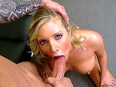 Domenic Kane is in possession of the largest cock in the world and he is getting a bj from a babe called Samantha Saint. This slutty blonde deepthroats and gags on that ginormous thing like a pro.