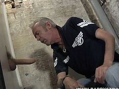 Check out grey-haired daddy having fun in the glory hole! He was super horny and sucked on the big schlong for a nice cumshot!