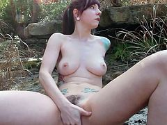 Ivy Snow is horny and in need to smash her cunt during outdoor solo masturbation