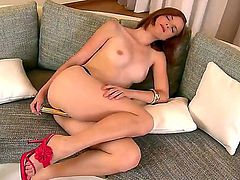 Turned on tempting and provocative redhead Denisa with natural tits and delicious ass gets naked and stuff hairy twat with golden vibrator while her lover films her in point of view.