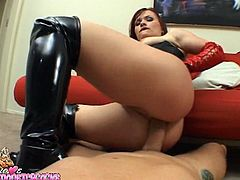 Nasty chick in corset and high boots lies on a sofa fondling her vagina. After that she gets fucked in her pussy and ass.
