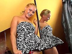Blonde Kathia Nobili is totally naked and plays with her pussy non-stop