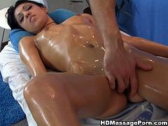After amazing slippery massage black haired Latina chick treats her masseur with blowjob. Then she lies on her side and gets screwd from behind.
