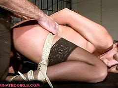 Julia Hunter is a perverse brunette milf who decided to wear black stockings in her visit to the dungeon. Watch her master tying her up and fingering her clam. Then it's time for her pussy to be banged balls deep into a breathtaking orgasm.