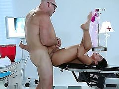 Black haired tempting bombshell Audrey Bitoni with big hooters and smoking hot ass gives had to doctor Johnny Sins with meaty cannon and gets banged hard from behind to orgasm.