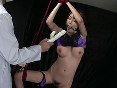 Fuckable Japanese harlow gets hanged to the ceiling with mouth bandaged by perverse doctors who tickle her bearded vagina with vibrator before poking her tight asshole with a dildo in sizzling hot sex video by Jav HD.