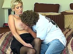 Shorthaired blonde milf is seduced to have screw by this man. She gets boobs caressed by him before kneeling and starting to perform so nice fellatio to the dude.