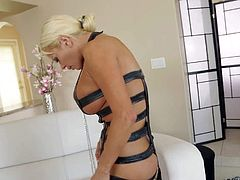 Nikita Von James is a blonde bombshell that demonstrates her huge melons and sexy shapely ass while dressing up. Watch seductive buxom pornstar put on her revealing black outfit.