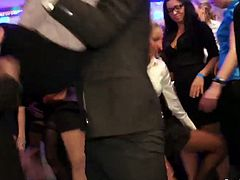 Playful white hussies in steamy office wear dance in the middle of the dance floor celebrating New Year's eve while showing off their long legs covered with pantyhose in sizzling hot group sex orgy by Tainster.