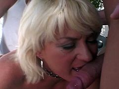 Watch this hot busty mom getting her all holes fucked hard in this hot outdoor threesome video.You will see her taking two cocks in her both holes at same time while sucking third one deep.