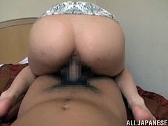 Naughty Japanese girl lies on a bed giving a blowjob to some guy. After that she gets her hairy pussy fucked from behind. Then she also gets facialed.