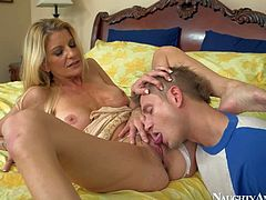 Robbye Bentley is a charming blond-haired mom of his best buddy. Milf with big tits and long legs turns him on. Sexy woman in white panties parts her legs and gets her snatch eaten out.