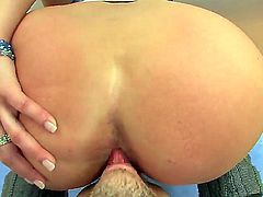 Cheep looking blonde Alanah Rae with gigantic jaw dropping melons and dark heavy make up gets her ass fingered and licked by horny dude in living room in close up.