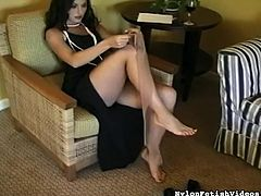 Dark-haired lady is dressing her stockings