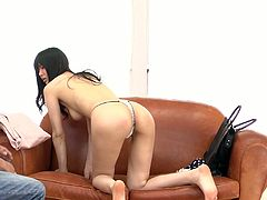 Steamy Japanese milf bends over a leather couch in front of kinky doctor to get finger fucked intensively before she sits with legs spread aside getting her beaver tickled with vibrator and poked with dildo simultaneously.