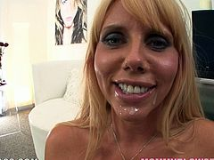 This gorgeous and lusty blond milf drops her huge tits out and now she wants you to stun, as she is going to blow your cock. Real hot POV to watch!