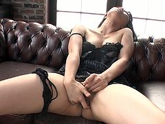 Mesmerizing Japanese milf in steamy black lingerie strokes her vagina with vibrator while sitting on the couch with legs spread aside before she gives blowjob to sturdy cock.