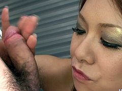 Filthy Japanese milf bites hard cock through trunks before she frees it to give it a zealous blowjob. Later she puts the trunks on to keep licking it with her mouth.