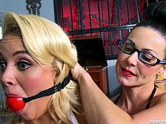 Milf Kendra Lust has her lesbian sex salve Alexia Monroe tied up with a ball gag in her mouth so she can't move or scream. Kendra licks Alexis's asshole and pussy until her little blonde sex slave desperately wants to return the favor to her master.