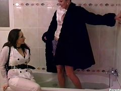 Two wicked MILF chicks take hot bath fully clothed. I don't know what will turn you on, their wet clothes or their stupid faces.