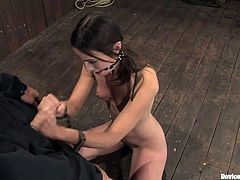 Have a look at this bondage video where this hot babe's tortured before she gives her master a handjob while wearing a gagball.