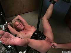 This petite blond mature Ginger Lynn is enjoying her time, being a sex slave. She gets some tight bondage and some severe penetration!
