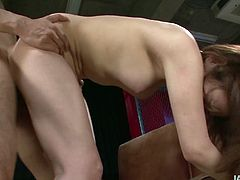 Frisky Japanese cutie gives zesty blowjob to oversized penis before she bends down for a hard fuck from behind. Later she gets on horny dude for a ride in cowgirl style.