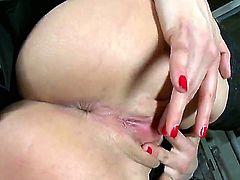 Brunette Eliska Cross polishing her pearl