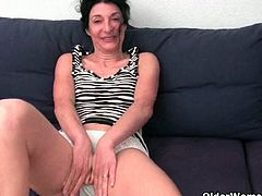 Lovely mature lady Emanuelle has a wet spot in her white panties and starts to rub her hairy pussy in front of the camera.