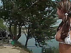 Cute blonde flashes and pisses all over the city fun to watch.
