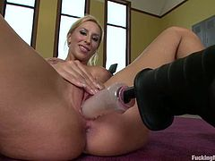 Sweet blonde girl with nice boobs sits on the floor and fondles her vagina. After that she also gets toyed in both holes by the fucking machine.