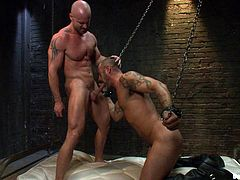 A couple of kinky dudes take it away in this perverted male on male scene right here where one is the slave and the other the dom.