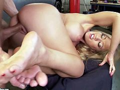 Busty blond whore stands in doggy style while getting her vagina pounded from behind before she uses her pedicured feet to stroke it in steamy sex clip by 21 Sextury.