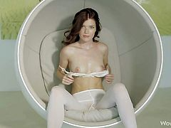 Red-haired young temptress Mia Sollis in reveling skin tight white pantyhose and shoes shows off her sexy long legs and pulls down her bra to show her perky natural tits. Shes a heartbreaker!