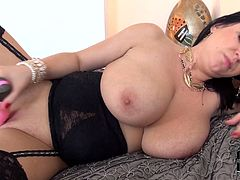 Voluptuous brunette mom with juicy jugs is lying on a bed wearing black corset and nylon stockings. She opens her legs inserting her favorite sex toy in her wet horny slit. She squeezes her boobs with joy poking her twat intensively. Hey, guys, you see she is craving for your cock! So join her right now!