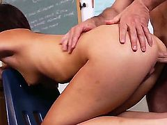 Filthy turned on professor John Strong with muscled body and long shaft seduces nerdy brunette bookworm Madelyn Monroe with provocative tattoo and fucks her hard all over the classroom.