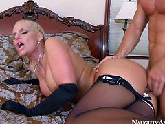 Dangerously sexy blonde milf Phoenix Marie is his wifes hot friend with big butt and huge melons. Big racked heartbreaker in black stockings gives head and gets her meaty pussy banged deep and hard on a king size bed.