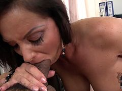 Voracious MILF with gorgeous body shape lies on a table in the office. She gets tit fucked intensively while sucking another dick deepthroat.
