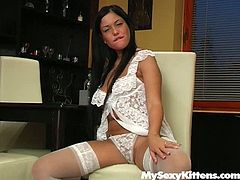 Messy brunette milf in steamy white lacy lingerie and stockings sits on the chair with legs spread aside fingering her cunt intensively before she starts pounding it with dildo in doggy position.