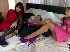 Two lustful chicks  jerks off dick of one cocky guy without taking of shoes