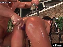 Oily hot bodied bitch riding cock gets ass dildo nailed