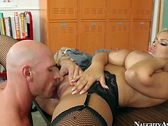 Dirty and slutty blonde teacher Bridgette B enjoys in giving her best student Johnny Sins one of the hottest and most arousing sex lessons in her classroom and sucks his rod