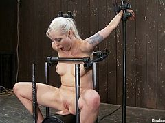 The blonde in this video is forced to ride a sybian while she's trapped and tied as this is all kinky BDSM with bondage and torturing action.