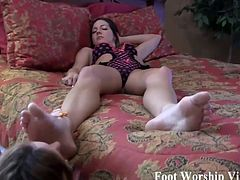 Sadie lays down on the bed and  Lady Bell straddles her with those sexy feet right in her face  She continues to lick on Sadies perfect soles and sucks on them freshly painted purple toes