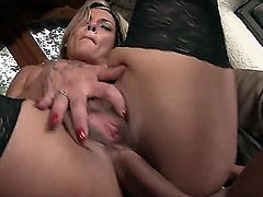 Blonde MILF gets her ass pounded by a huge cock and later gives him a deep throat blowjob