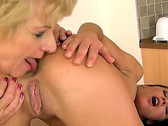 Slender black haired babe Melane with tight ass and arousing make up and short haired blonde granny Sally G. in stockings only lick each other to orgasms in close up.