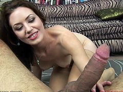 A gorgeous brunette cutie sucks on a hard cock till the dude blasts a hefty load of cum on her motherfucking face. Check it out!