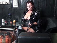 She is trashy mature woman with white fat ass. She is wearing leather corset and total freaky outfit. She moans getting her clam eaten.