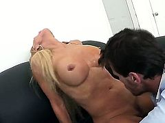 Tanned whorish blonde milf Amber Lynn with big fake tits and cheep heavy make up gives head to handsome Manuel Ferrara and gets her minge pounded to orgasm on couch.